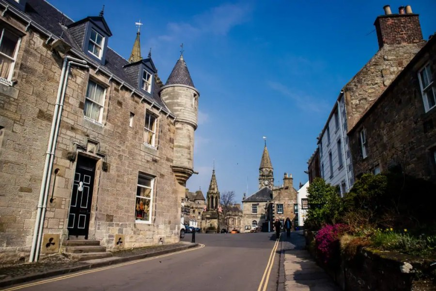 The town centre of Falkland with the iconic market cross and Covenanter Hotel in the distance.