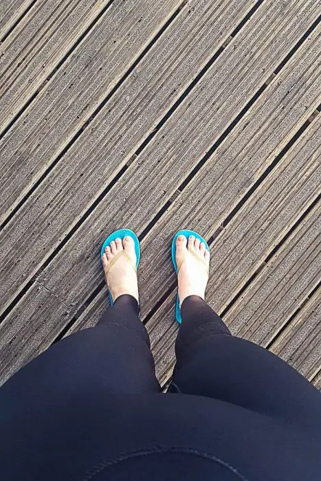 My feet in a wetsuit and flip flops