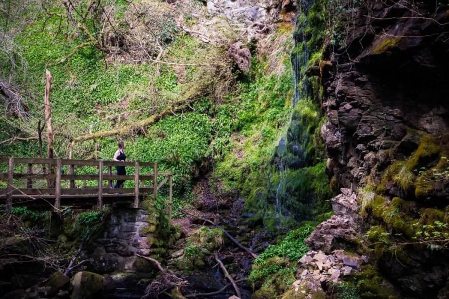 North Coast 500: A woman at a waterfall near Golspie