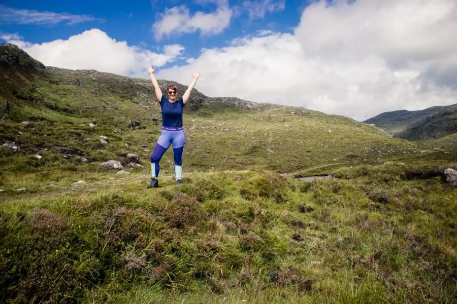 Enjoying mountain views on Harris in my new colourful base layers.