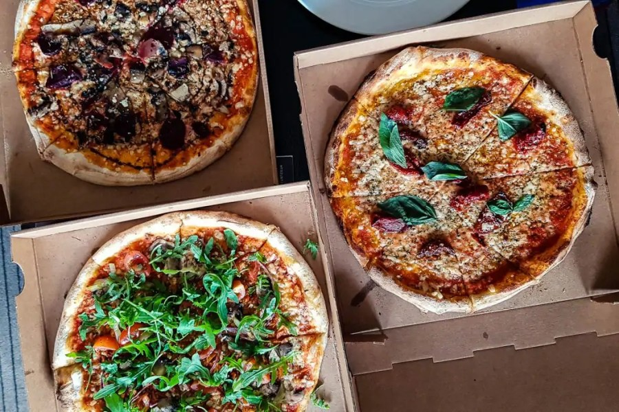 Takeaway pizza from Romans Pizzeria.