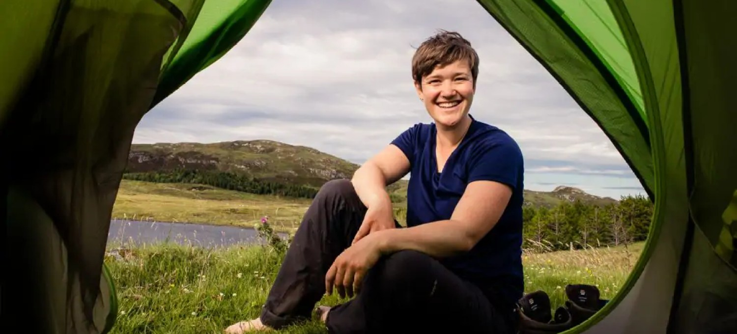 Travel writer and hiker Kathi Kamleitner outside her tent on the Hebridean Way in Scotland.