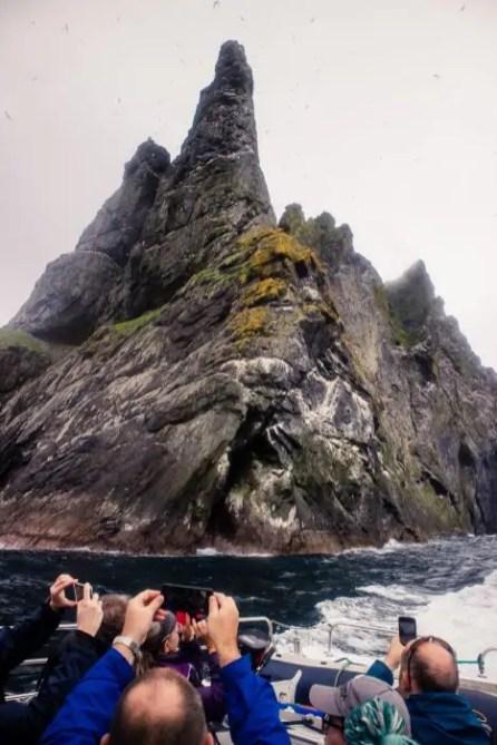 St Kilda visitors photographing the sea stacs of St Kilda