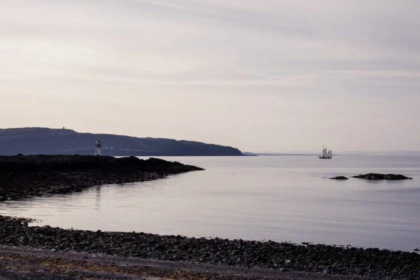 A sail boat for sunrise at Glencallum Bay.
