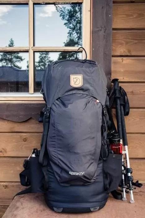 a28c7e6f3111 The Fjallraven Abisko 65 L backpack on a bench in Sweden - The best trekking  backpacks