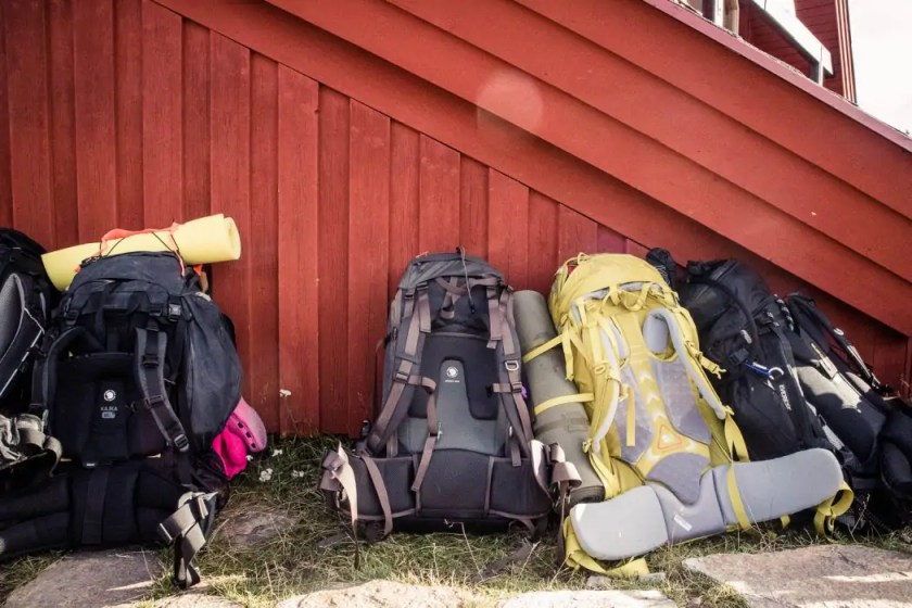 a93732f2cb18 Backpacks in front of a red wall in Sweden. - The best trekking backpacks