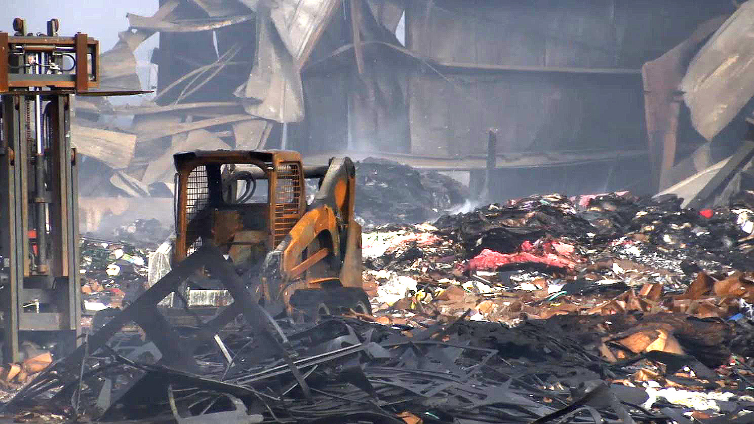 COVER PHOTO_Recycling Center fire debris_0503_1556916169663.JPG.jpg