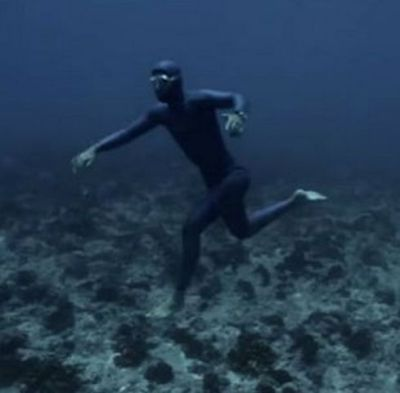 underwater man walking on ocean bed