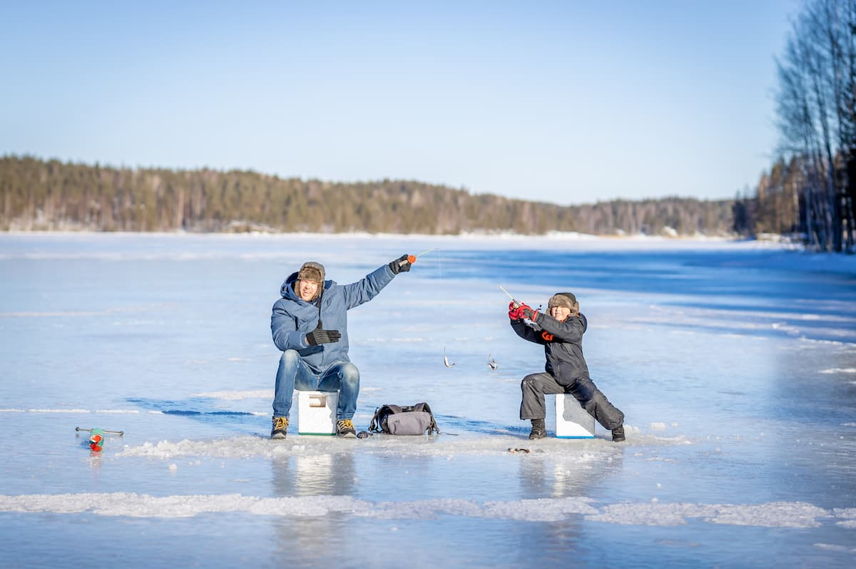 A father and son ice fishing on Wolfe Lake.