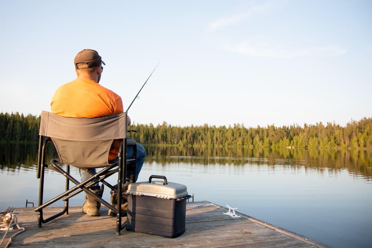 An older man fishing on a dock near Westport.