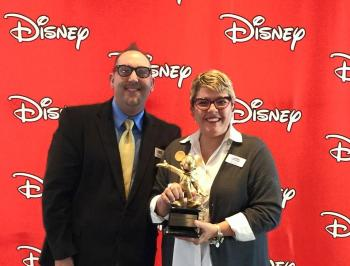 Orlando Fringe Executive Director George Wallace and President Joyce Arbucias accept a 2015 grant from Disney.