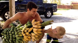 Water Wise founder Toby Lawrence and his son David admiring their rain water fed home grown bananas