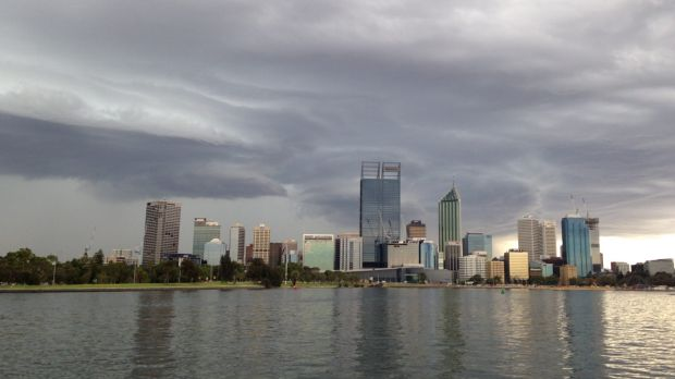 Storm clouds loom over Perth city.