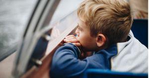boy gazes out a window
