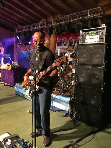 Carl Young, bassist with Michael Franti & Spearhead, currently on tour with a 4000 watt wall of pure power