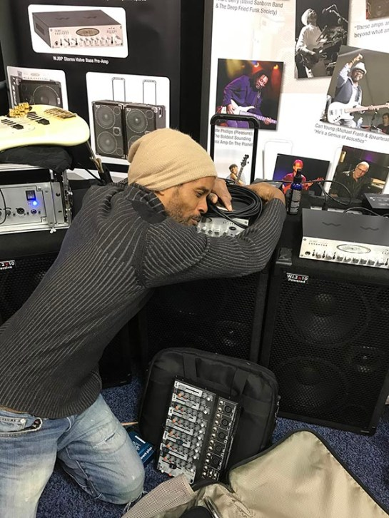 André Berry displaying his affection for the new Wayne Jones AUDIO WJBPII Twin Channel Bass Pre-Amp released at NAMM 2017