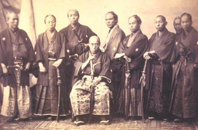 Figure 1: Shibata (seated) with his onmitsu in Paris 1867. Taken from website.