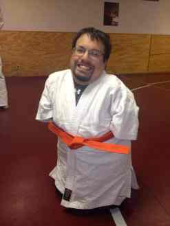 Jujitsu class with orange belt