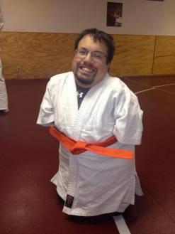 Jujitsu class with orange belt