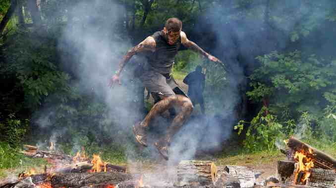 Spartan Race (obstacle course race fire jump)