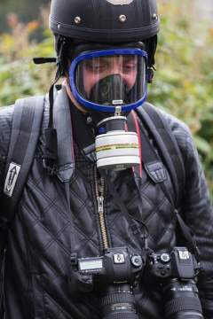 Journalist wearing a gas mask