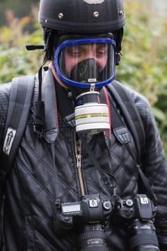 Journalist wearing a gas mask