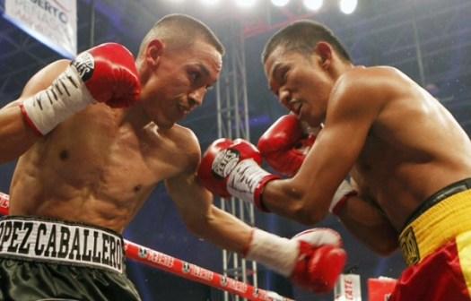 Estrada stops Mepranum, retains WBA/WBO belts