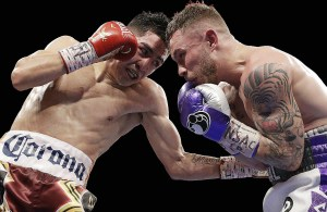 """""""I fought a great fighter,"""" said Santa Cruz, """"and let's make a third fight."""" (Photo: AP)"""