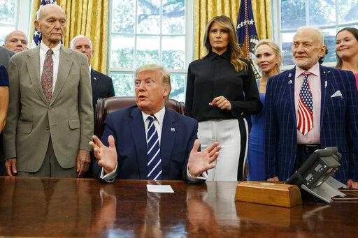 Donald Trump, Mike Pence, Melania Trump, Michael Collins, Buzz Aldrin