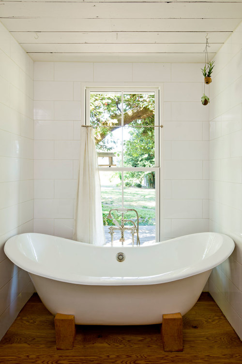 A tub in a tiny house is a luxury, but his reclamed tub makes this space luxurious.
