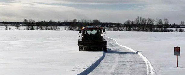 snowmobile trail grooming first pass on open field