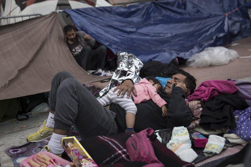 migrants seek asylum_1525166772128.jpeg.jpg