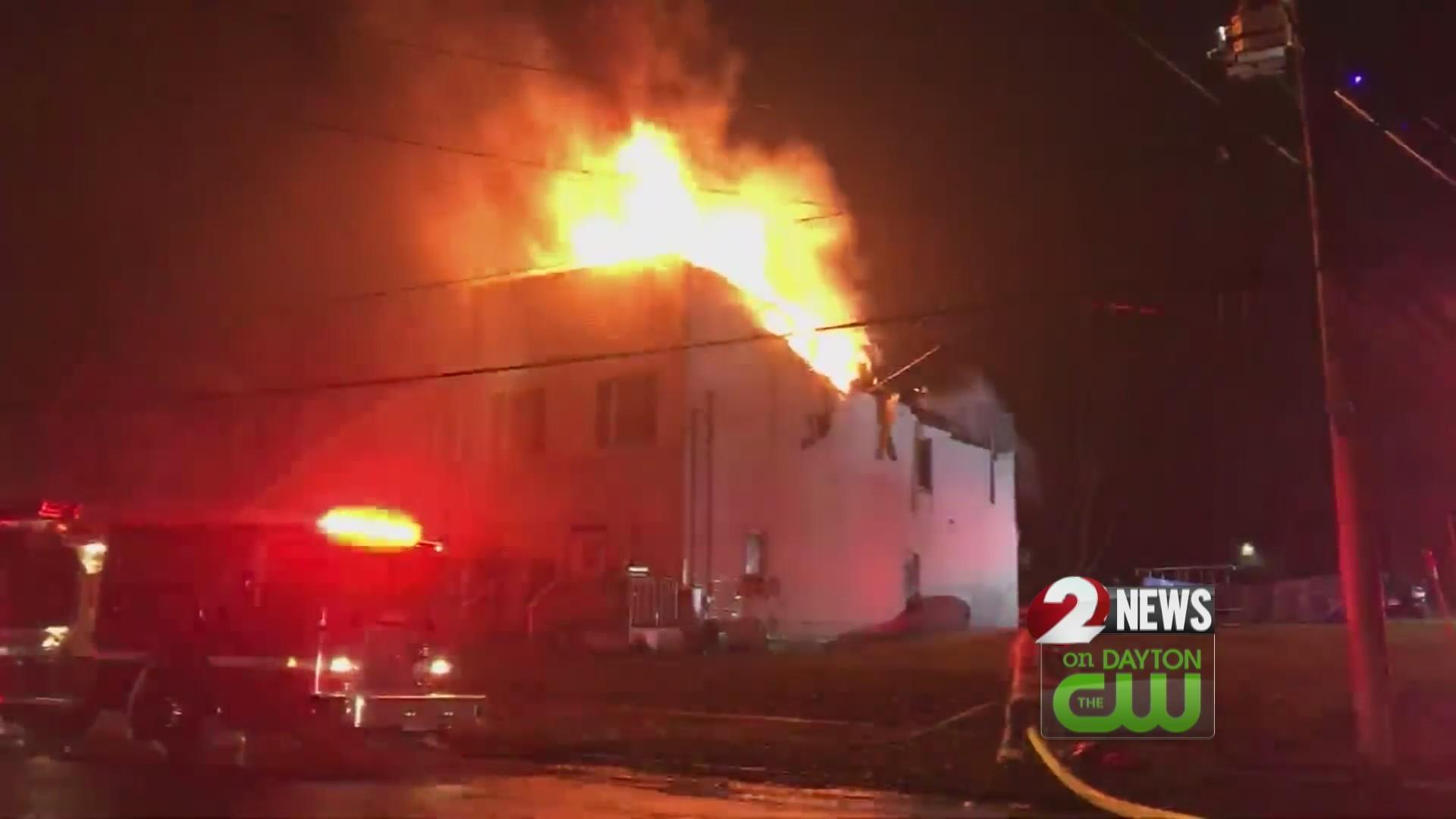 Officer hailed hero for saving 8 from burning duplex