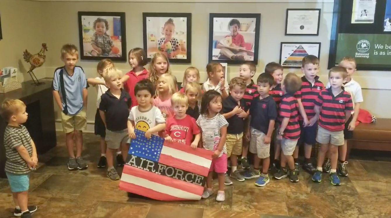 Preschoolers sing Happy Birthday to Air Force