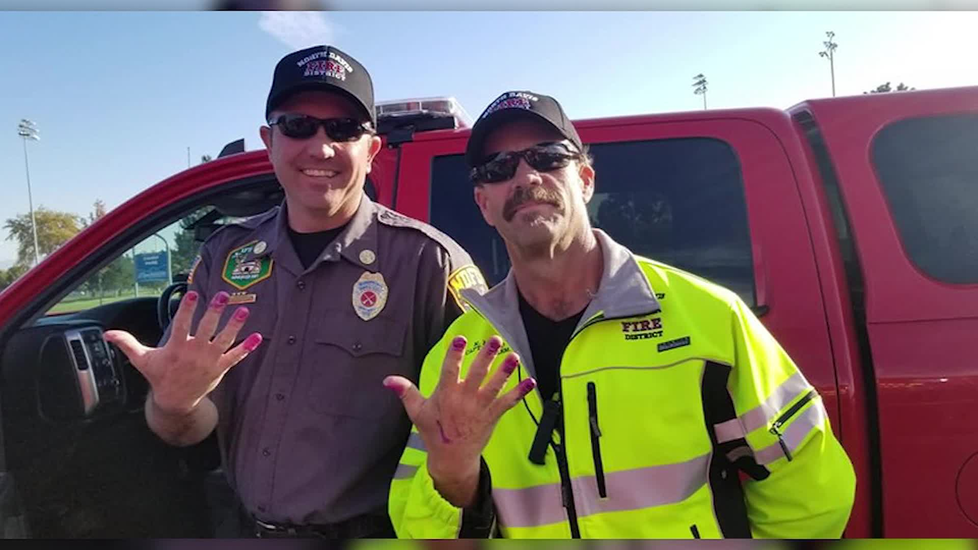 Girl paints firefighters' nails