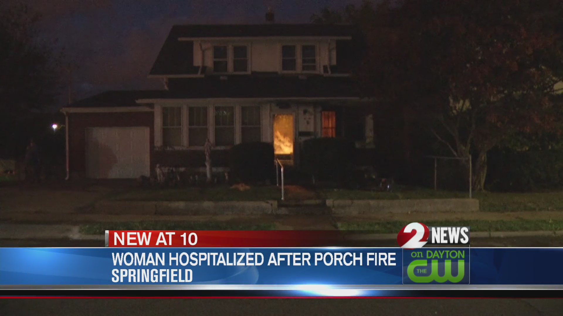 Woman hospitalized after porch fire