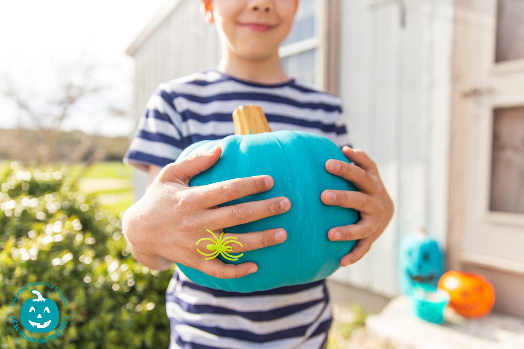 Boy Holding Teal Pumpkin[39438]