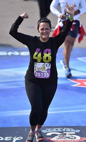 Crossing the finish line of the Full Marathon to complete the Dopey Challenge