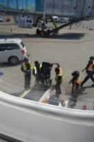 Transferring Andrew's wheelchair to the cargo hold