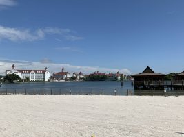"alt=""View of the Grand Floridian and the Polynesian Village resorts from the running trail."""