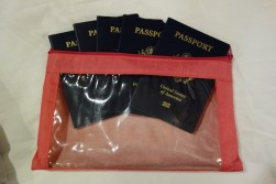 "alt=""clear plastic zipper pouch for storing travel passports"""