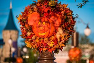"alt=""Halloween pumpkin light posts at Disney's Magic Kingdom."""