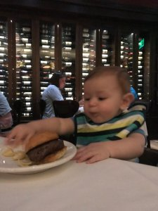 Ben Mulka eating Filet Slider at The Boathouse in Disney Springs