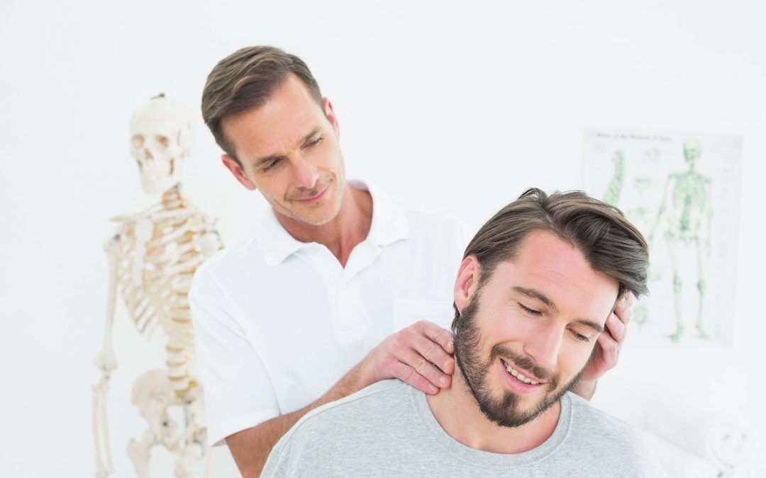 chiropractor massaging a patient on the neck