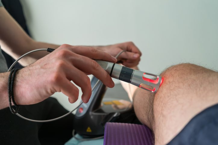 cold laser therapy applied on patient leg