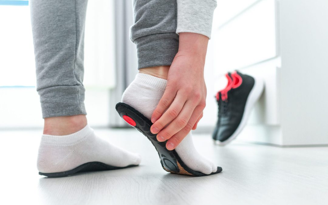 A person holding his heel