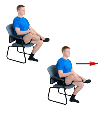 Person sits on chair doing Seated Piriformis Stretch