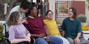 People with Learning Disabilities smiling and laughing.