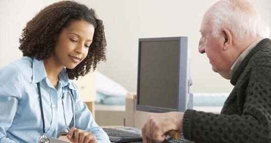 Doctor talking to elderly patient