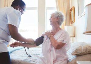 Elderly Care Home resident having blood pressure taken